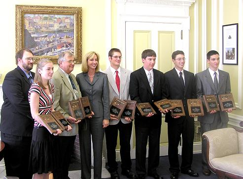 Jr Pistol Team showing off their awards with Lt Gov Healy